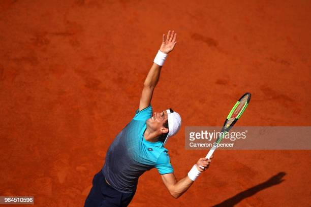 Guido Pella of Argentina serves during the mens singles second round match against Rafael Nadal of Spain during day five of the 2018 French Open at...