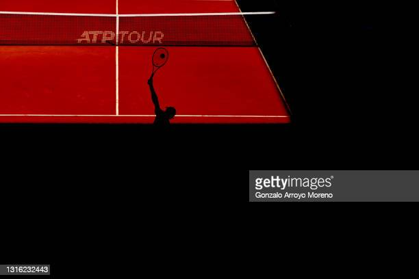 Guido Pella of Argentina serves in his mens singles match against Jannik Sinner of Italy during day six of the Mutua Madrid Open at La Caja Magica on...