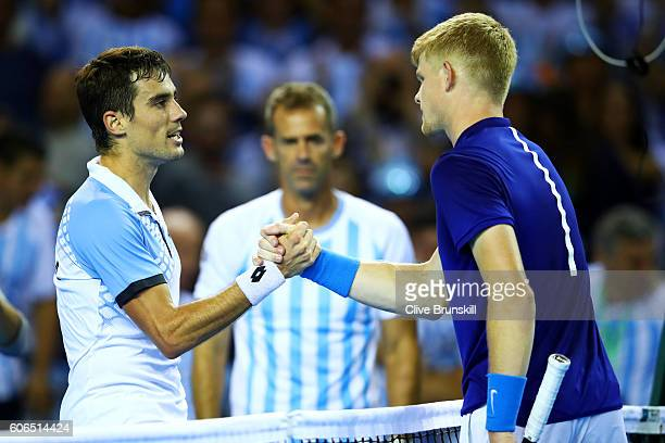Guido Pella of Argentina shakes hands with Kyle Edmund of Great Britain after their singles match during day one of the Davis Cup Semi Final between...