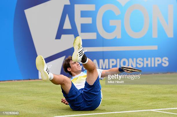 Guido Pella of Argentina slips during his Men's Singles first round match against Daniel Evans of Great Britain on day one of the AEGON Championships...