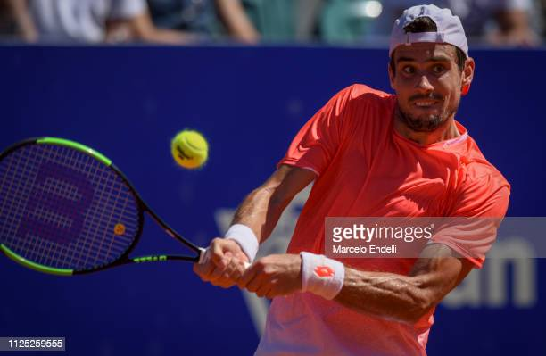 Guido Pella of Argentina takes a backhand shot during a semifinal match against Marco Cecchinato of Italy as part of Argentina Open ATP 250 2019 at...