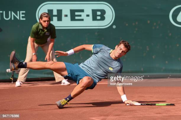 Guido Pella slips on the clay court during his match against Sam Querrey during the 2018 US Men's Clay Court Tennis Championships on April 11 2018 at...