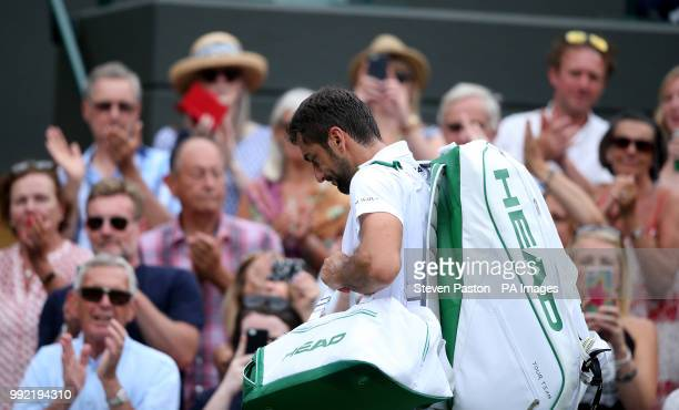 Guido Pella walks off courts after winning his match against Marin Cilic on day four of the Wimbledon Championships at the All England Lawn Tennis...