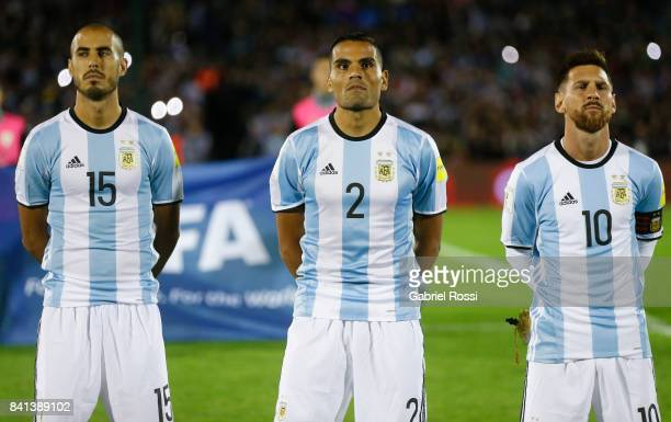Guido Pizarro Gabriel Mercado and Lionel Messi of Argentina line up for the National Anthem prior to a match between Uruguay and Argentina as part of...