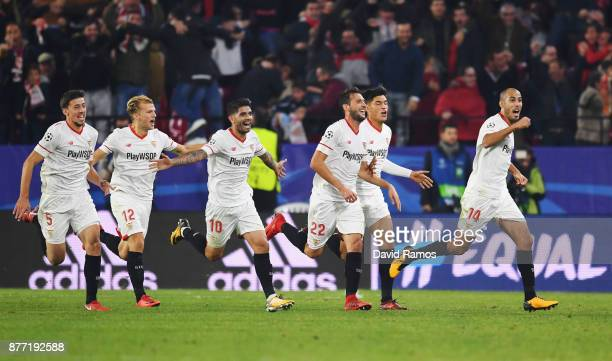Guido Pizarro of Sevilla celebrates scoring his sides third goal during the UEFA Champions League group E match between Sevilla FC and Liverpool FC...