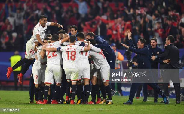 Guido Pizarro of Sevilla celebrates with team mates and staff members after scoring his sides third goal during the UEFA Champions League group E...