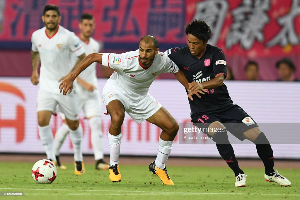 Guido Pizarro of Sevilla FC (L) controls the ball against Ryuji Sawakami of Cerezo Osaka (R) during the preseason friendly match between Cerezo Osaka and Sevilla FC at Yanmar Stadium Nagai on July 17, 2017 in Osaka, Japan.