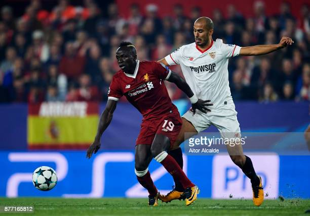Guido Pizarro of Sevilla FC duels for the ball with Sadio Mane of Liverpool FC during the UEFA Champions League group E match between Sevilla FC and...