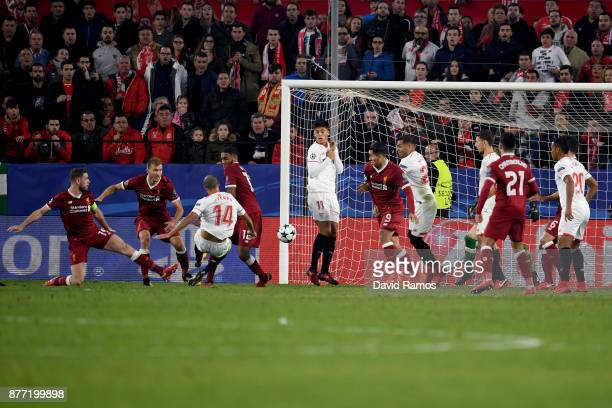 Guido Pizarro of Sevilla scores his sides third goal during the UEFA Champions League group E match between Sevilla FC and Liverpool FC at Estadio...