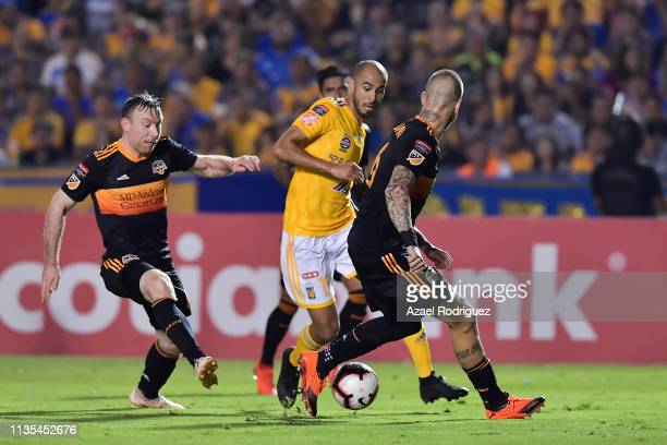 Guido Pizarro of Tigres fights for the ball with Matías Vera and Aljaz Struna of Houston Dynamo during the match between Tigres UANL and Houston...