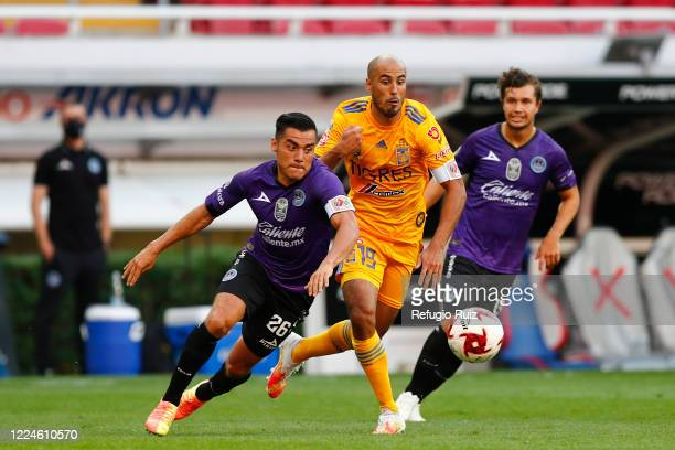 Guido Pizarro of Tigres fights for the ball with Paul Rocha of Mazatlan during the match between Mazatlan FC and Tigres UANL as part of friendly...