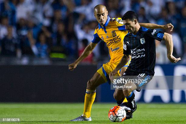 Guido Pizarro of Tigres struggles for the ball with Antonio Naelson of Queretaro during the semifinal first leg match between Queretaro and Tigres...