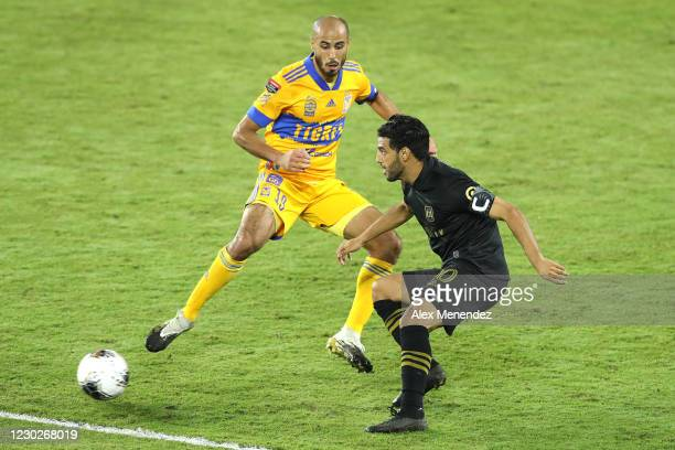 Guido Pizarro of Tigres UANL and Carlos Vela of Los Angeles FC play the ball during the CONCACAF Champions League final game at Exploria Stadium on...