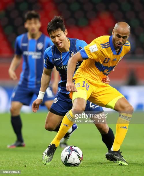 Guido Pizarro of Tigres UANL looks to break past Kim Tae-hwan of Ulsan Hyundai during the FIFA Club World Cup Qatar 2020 Second Round match between...