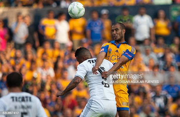 Guido Pizarro of Tigres vies for the ball with Dorlan Pabon of Monterrey during the first leg of the quarterfinal of the Mexican Clausura 2016...