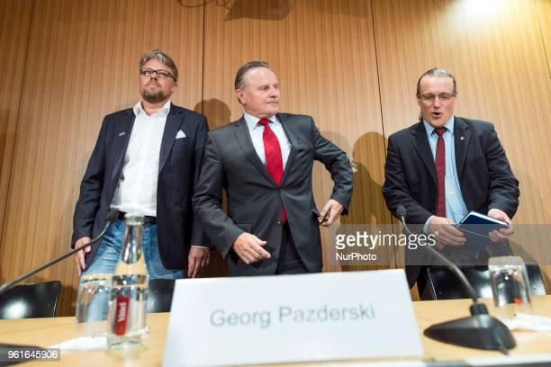 Guido Reil Georg Pazderski and Steffen Koeniger of Antiimmigration populist Alternative fuer Deutschland party arrive to a press conference regarding...