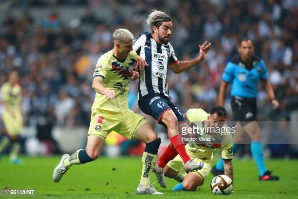 Guido Rodríguez of America struggles for the ball against Rodolfo Pizarro of Monterrey during the Final first leg match between Monterrey and America...