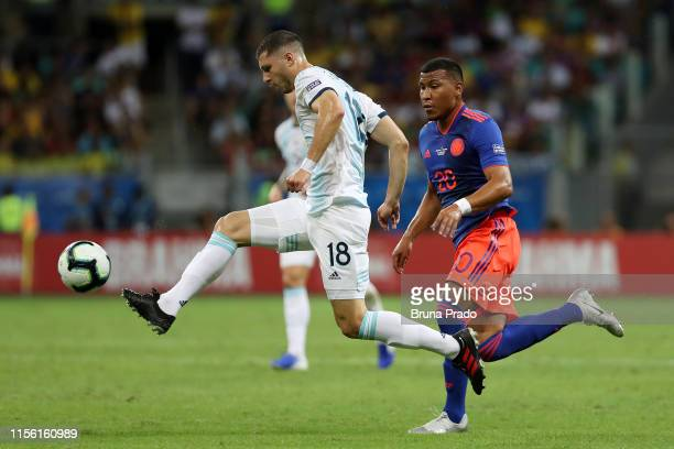Guido Rodríguez of Argentina kicks the ball against Roger Martínez of Colombia during the Copa America Brazil 2019 group B match between Argentina...