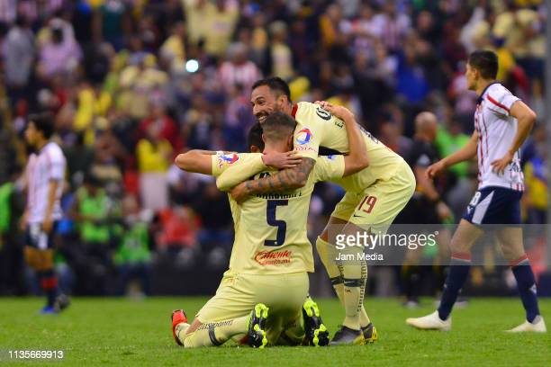 Guido Rodriguez and Carlos Vargas of America celebrates the second goal of his team during the quarterfinals match between America and Chivas as part...