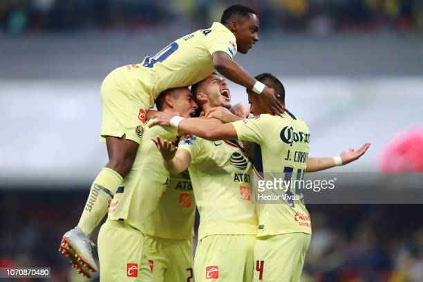 Guido Rodriguez of America celebrates with teammates after scoring the 4th goal of his team during the semifinal second leg match between America and...