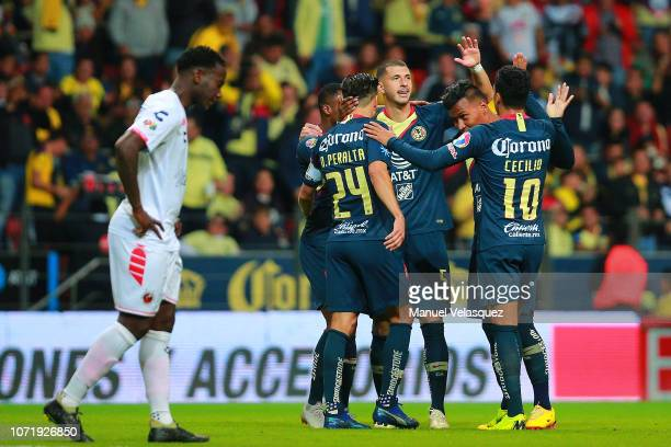 Guido Rodriguez of America celebrates with teammates after scoring the second goal of his team previous the 17th round match between America vs...
