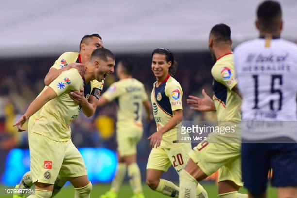Guido Rodriguez of America celebrates with teammates after scoring the fourth goal with teammates during the semifinal second leg match between...