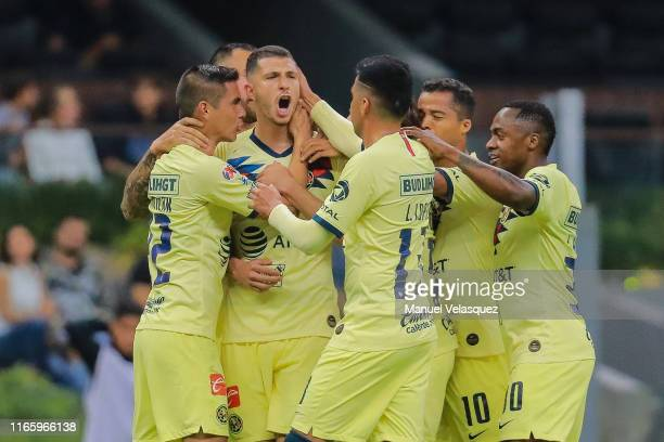 Guido Rodriguez of America celebrates with teammates after scoring the first goal of his team during the 3rd round match between America and Tijuana...