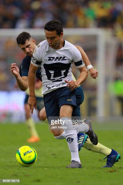 Guido Rodriguez of America fights for the ball with Erick Torres of Pumas during the quarter finals second leg match between America and Pumas UNAM...