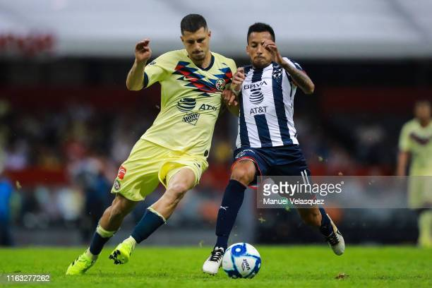 Guido Rodriguez of America struggles for the ball against Leonel Vangioni of Monterrey during the 1st round match between America and Monterrey as...