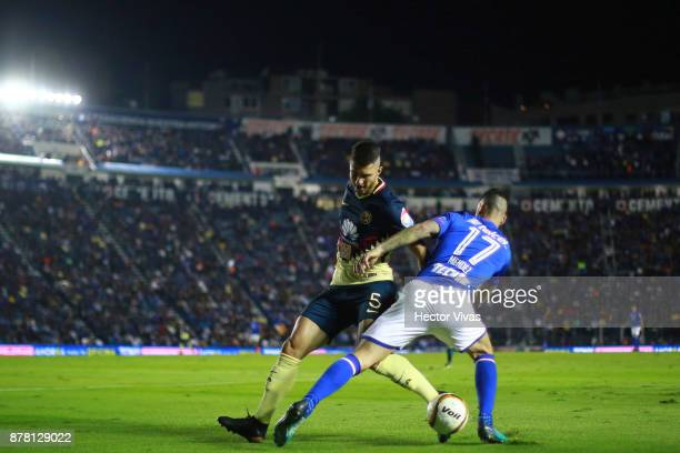 Guido Rodriguez of America struggles for the ball with Edgar Mendez of Cruz Azul during the quarter finals first leg match between Cruz Azul and...