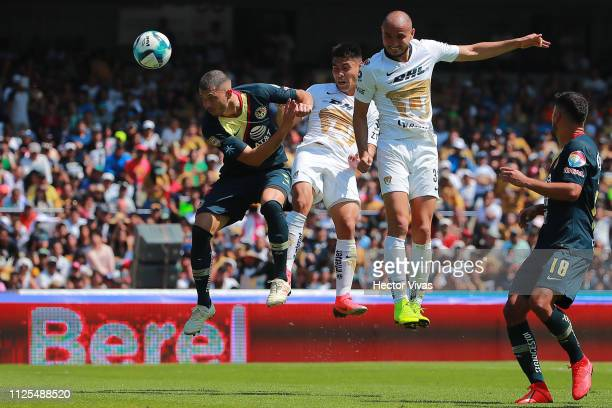 Guido Rodriguez of America struggles for the ball with Felipe Mora and Carlos Gonzalez of Pumas during the seventh round match between Pumas UNAM and...