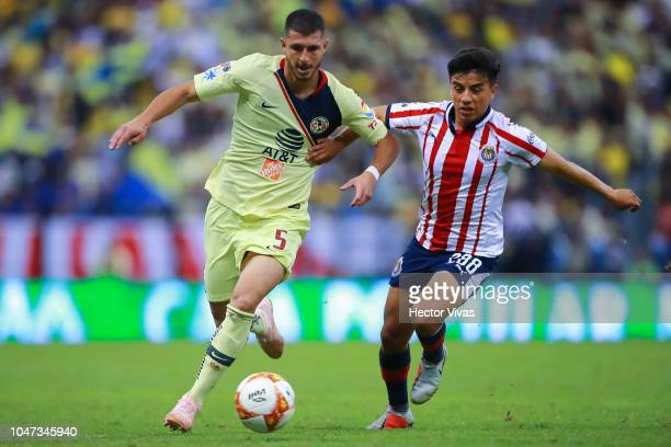 Guido Rodriguez of America struggles for the ball with Fernando Beltran of Chivas during the 11th round match between America and Chivas as part of...