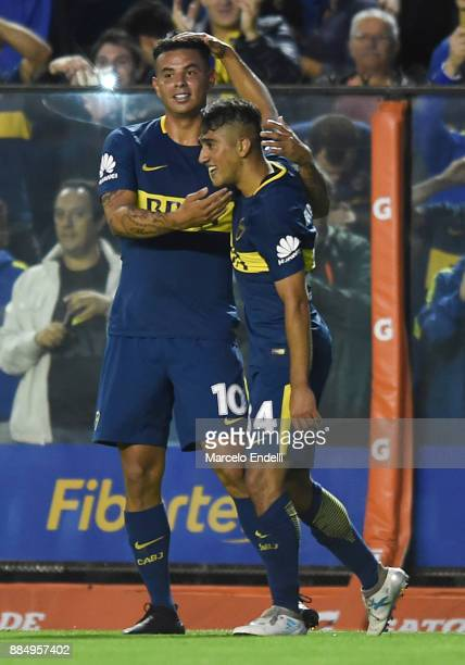 Guido Vadala of Boca Juniors celebrates with teammate Edwin Cardona after scoring the first goal of his team during a match between Boca Juniors and...