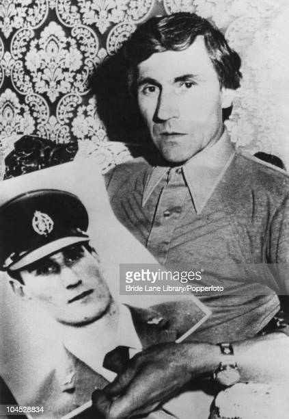 Guido Valentich holds a photograph of his son Frederick a pilot who went missing three days earlier whilst on a flight from Melbourne to King Island...