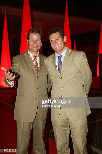 Guido Westerwelle and friend Michael Mronz at BILD summer festival at Axel Springer publishing house in Berlin