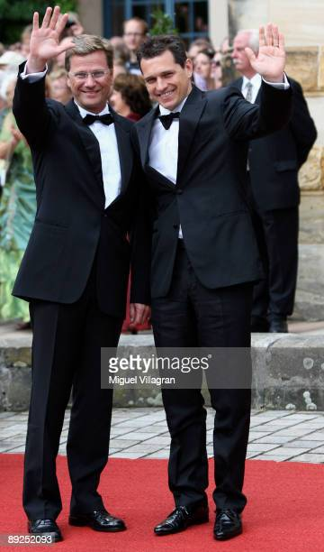 Guido Westerwelle and his boyfriend Michael Mronz arrive for the 'Tristan and Isolde' premiere of the Richard Wagner festival on July 25 2009 in...