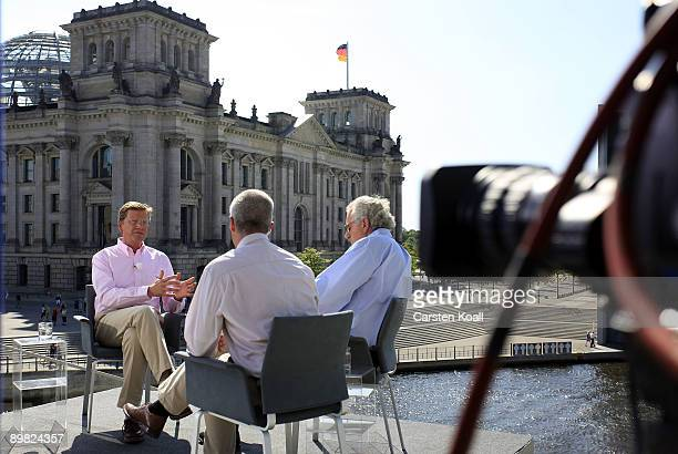 Guido Westerwelle head of the German Free Democrats speaks during his traditional summer interview on ARD television with hosts Rainald Becker and...