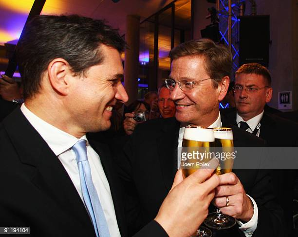 Guido Westerwelle leader of Free Democratic Party celebrates with his boyfriend Michael Mronz during the FDP election night party after reaching 146...