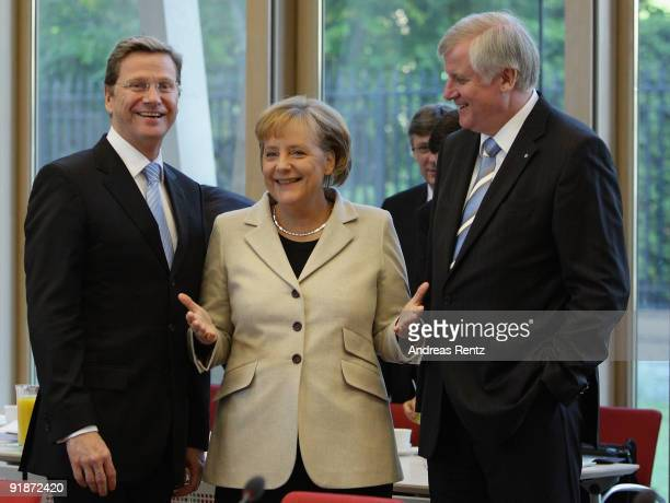 Guido Westerwelle leader of the German Free Democrats German Chancellor and Chairwoman of the German Christian Democrats Angela Merkel and Chairman...