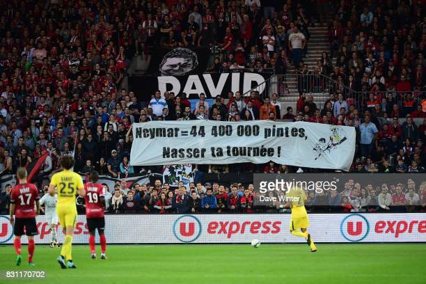 Guigamp fans hold up a banner suggesting how many pints of beer you could buy for the price PSG president Nasser AlKhelaifi paid for Neymar JR during...