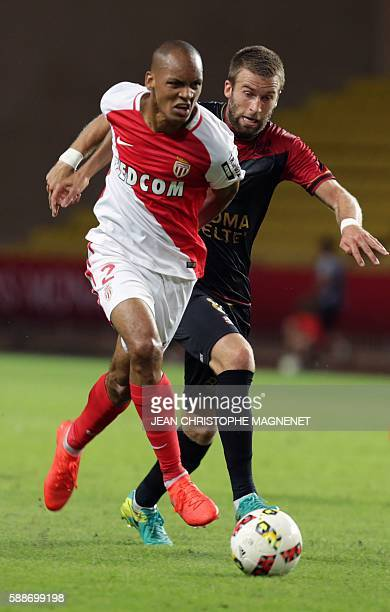 Guigamp's French midfielder Lucas Deaux vies with Monaco's Brazilian defender Fabinho during the French L1 football match between Monaco and Guingamp...
