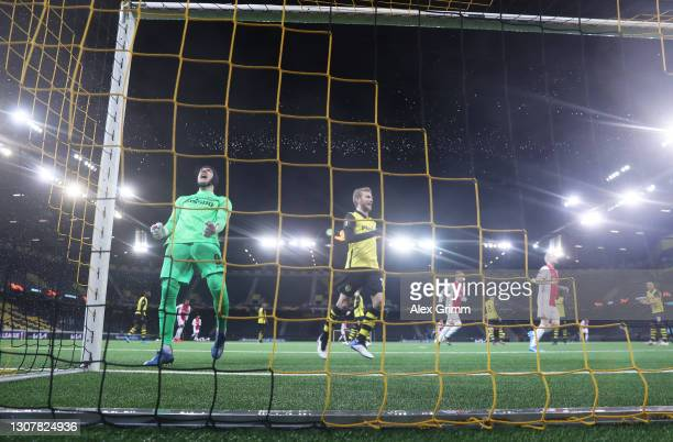 Guilaume Faivre of BSC Young Boys reacts after Ajax's second goal scored by Dusan Tadic from the penalty spot during the UEFA Europa League Round of...