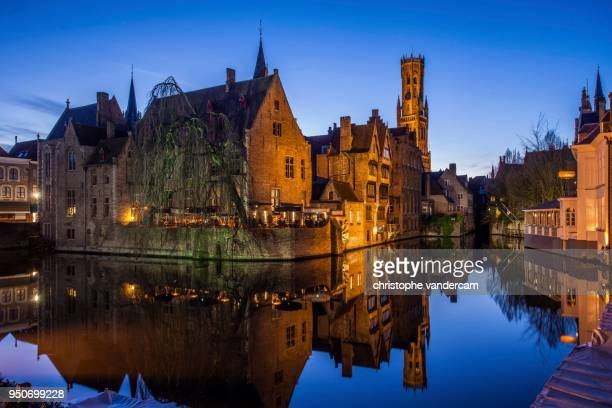 guild houses in front of the belfry at dusk, historic centre at rozenhoedkaai, unesco world heritage site, bruges, flemish region, belgium - ブルージュ ストックフォトと画像