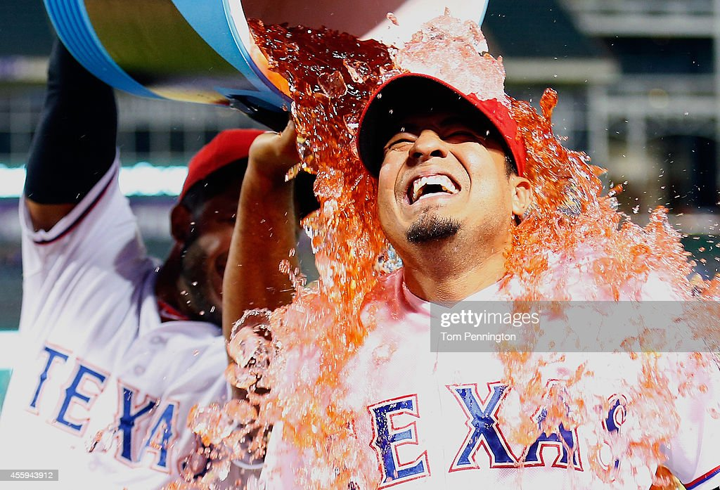 Guilder Rodriguez #60 of the Texas Rangers reacts after being soaked with a water cooler by Elvis Andrus #1 of the Texas Rangers after the Rangers beat the Houston Astros 4-3 at Globe Life Park in Arlington on September 22, 2014 in Arlington, Texas.