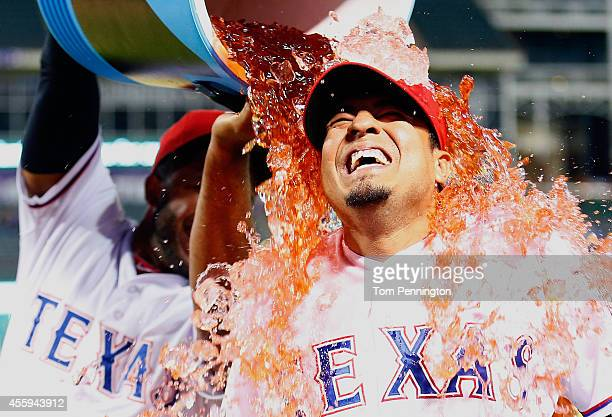 Guilder Rodriguez of the Texas Rangers reacts after being soaked with a water cooler by Elvis Andrus of the Texas Rangers after the Rangers beat the...
