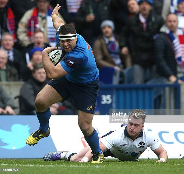 Guilhem Guirado of France breaks clear of Stuart Hogg to score the first try during the RBS Six Nations match between Scotland and France at...