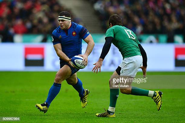 Guilhem Guirado of France is challenged by Jared Payne of Ireland during the RBS Six Nations match between France and Ireland at the Stade de France...