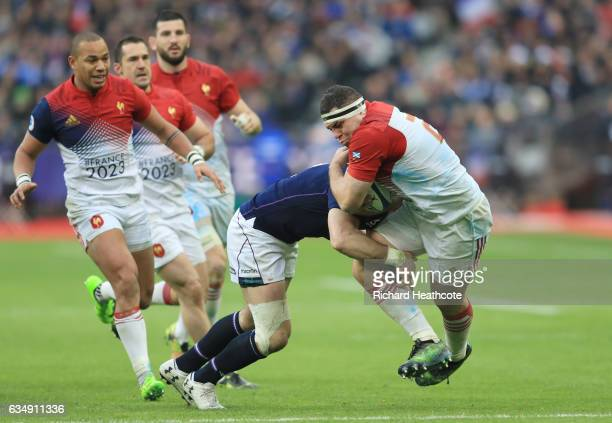 Guilhem Guirado of France is tackled by Alex Dunbar of Scotland during the RBS Six Nations match between France and Scotland at Stade de France on...
