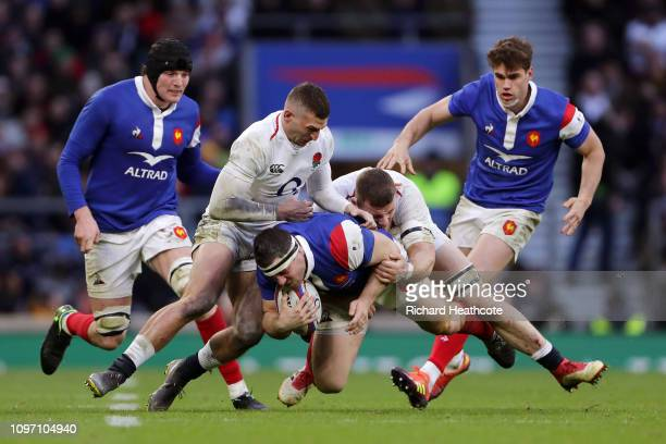 Guilhem Guirado of France is tackled by Jonny May and Mark Wilson of England during the Guinness Six Nations match between England and France at...