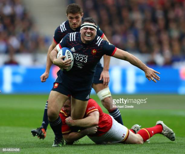 Guilhem Guirado of France is tackled by Ken Owens of Wales during the RBS Six Nations match between France and Wales at the Stade de France on March...
